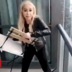Woman throws chair from high-rise balcony